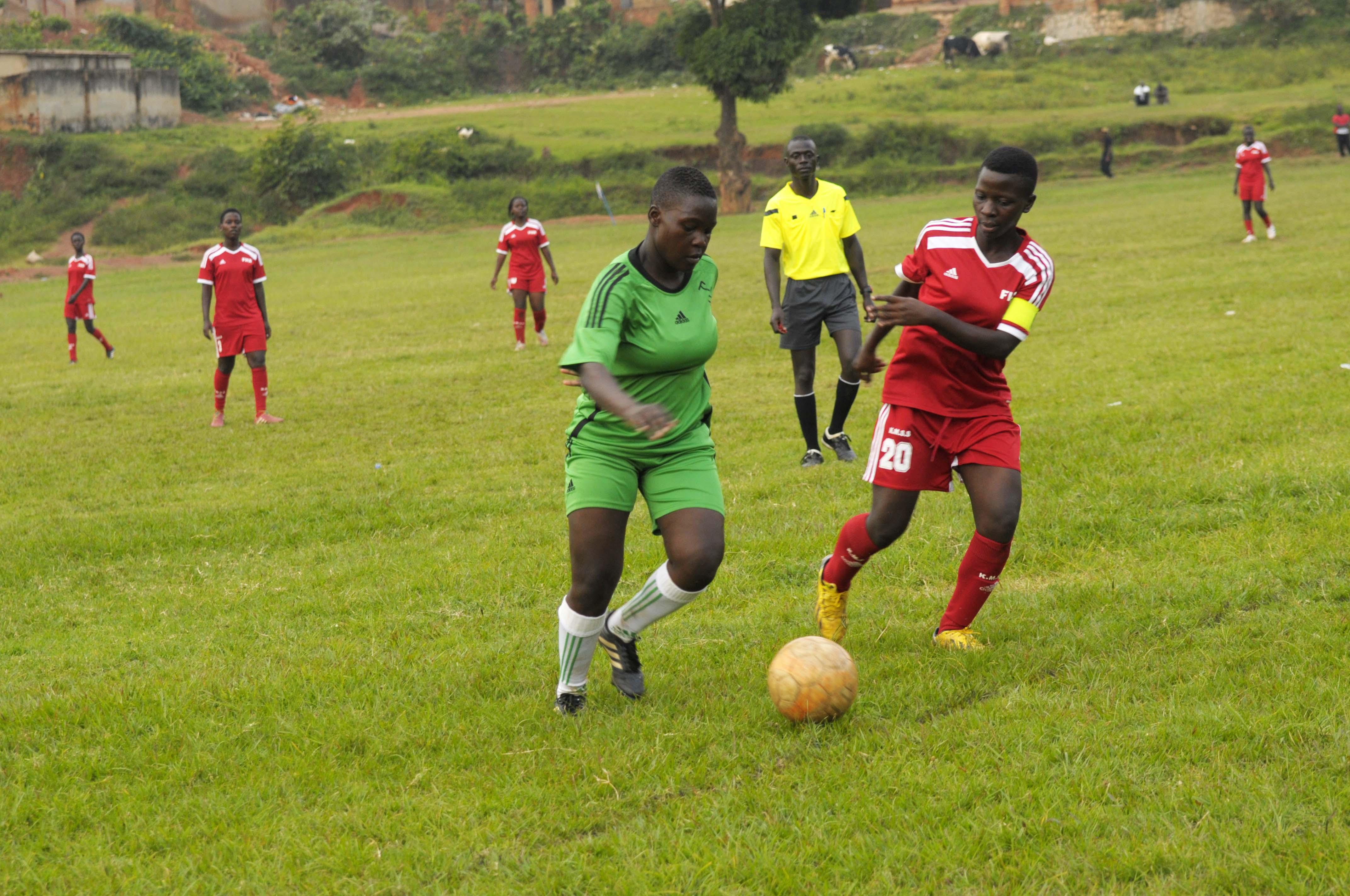 Kawempe's Sandra Nabweteme (r) against Makerere's Nanziri Lilian
