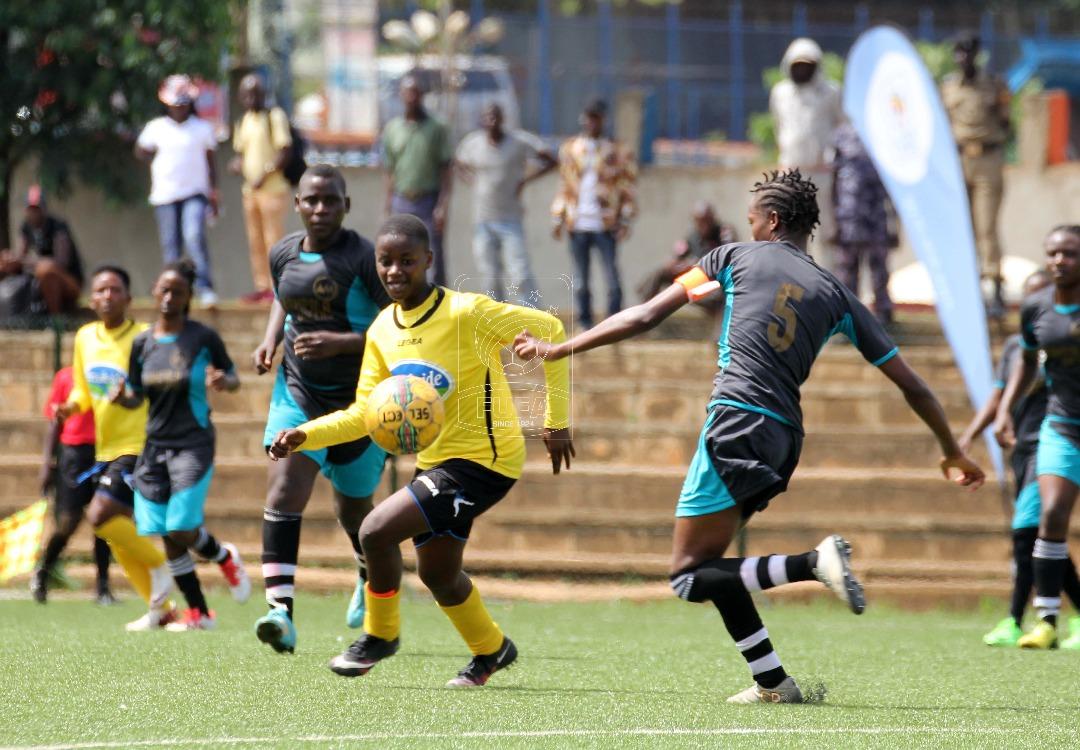 Juliet Nalukenge in action against Kampala Quuens
