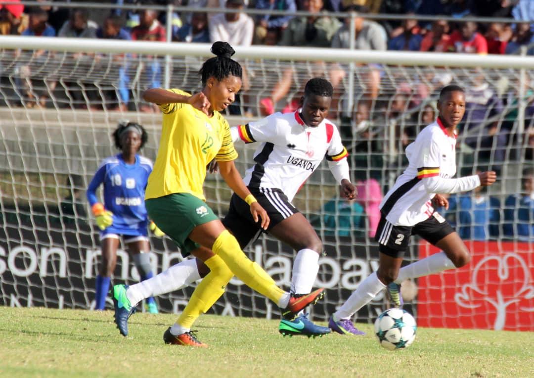 South Africa's Jermaine Seoposonwe encounters Crested Cranes defenders Aluka Grace (Centre) and Namukisa Aisha (2)