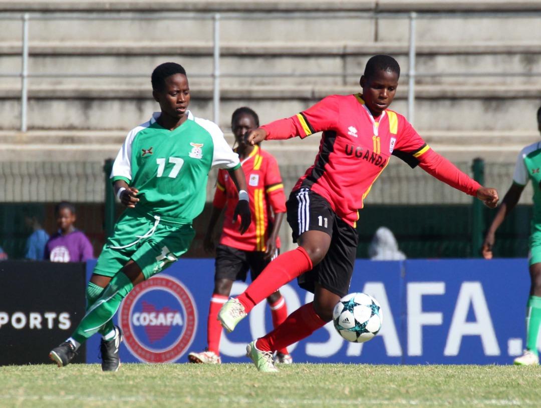 Crested Cranes Nalugya Shamilah dribbles past Zambia's Mary Mwakapila